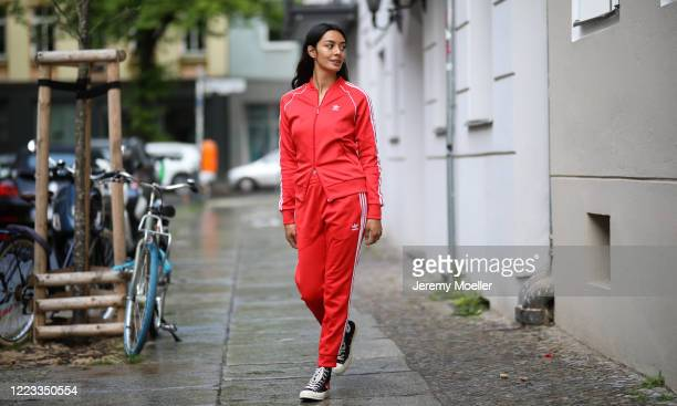 Alyssa Cordes wearing Adidas tracksuits and Converse sneaker on May 05, 2020 in Berlin, Germany.