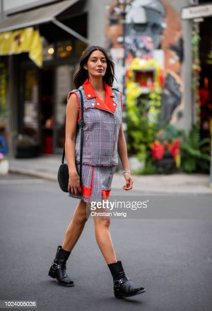 Alyssa Cordes wearing checked sleeveless jacket with orange collar and skirt Lala Berlin Lili Radu bag the Kooples boots on August 24 2018 in Berlin...