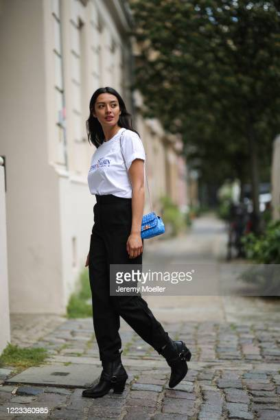 Alyssa Cordes wearing LalaBerlin pants, Mango boots, Home again Shirt and Valentino bag on May 05, 2020 in Berlin, Germany.