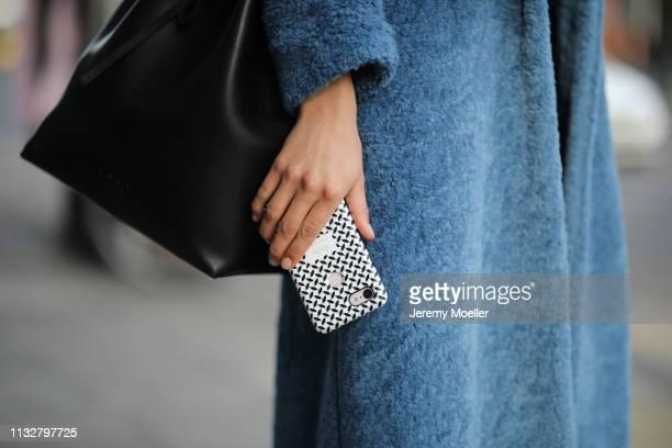 Alyssa Cordes wearing Samsoe Samsoe jacket lalaBerlin Iphone Case and Velt bag on February 28 2019 in Berlin Germany