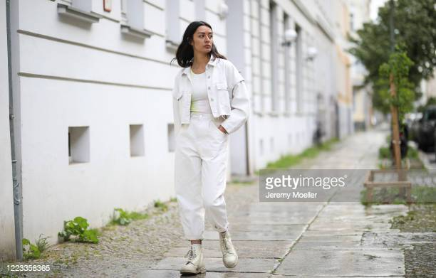 Alyssa Cordes wearing Zara jeans combi, Dr Martens shoes and Urban Outfitters shirt on May 05, 2020 in Berlin, Germany.