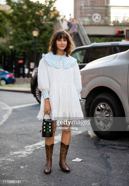 Alyssa Cosacrelli is seen wearing white dress, brown cowboy boots outside Anna Sui during New York Fashion Week September 2019 on September 09, 2019...