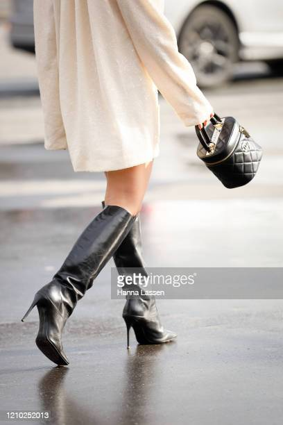 Alyssa Coscarelli, bag detail, wearing Chanel ivory dress, black Chanel bag and black boots outside the Chanel show during Paris Fashion Week...
