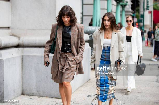 Alyssa Coscarelli is seen wearing brown plaid shorts and blazer and Lauren Caruso wearing plaid skirt outside Sies Marjan during New York Fashion...