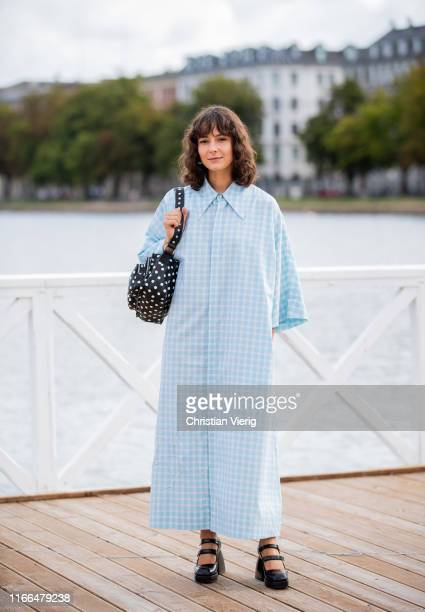 Alyssa Coscarelli is seen wearing white blue plaid button up dress black bag with white dots outside Blanche during Copenhagen Fashion Week...