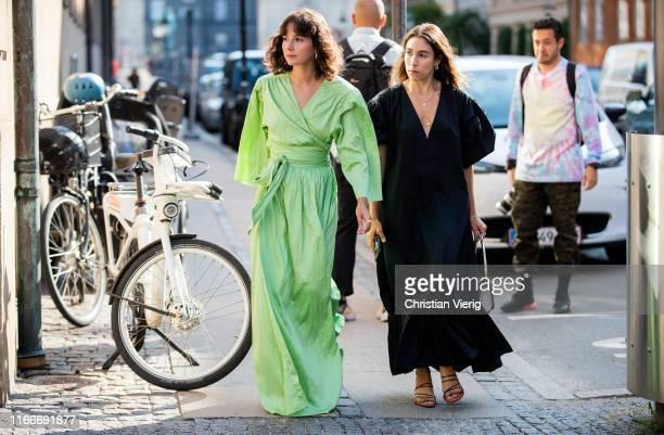 Alyssa Coscarelli wearing green dress Rodebjer and Lauren Caruso wearing black dress is seen outside Helmstedt during Copenhagen Fashion Week...
