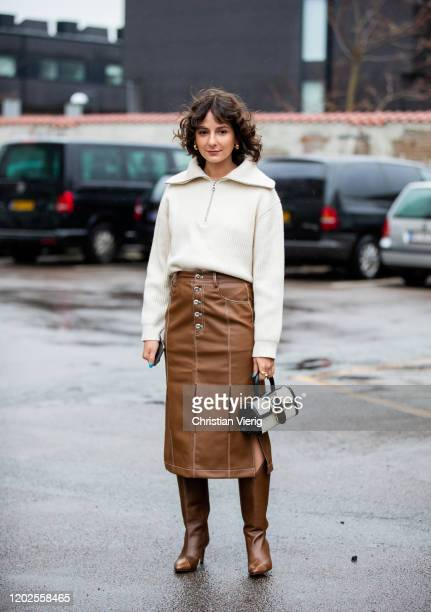 Alyssa Coscarelli wearing sweater zipper, brown skirt with slits, brown boots, two tone black white bag seen outside Carcel on Day 1 during...