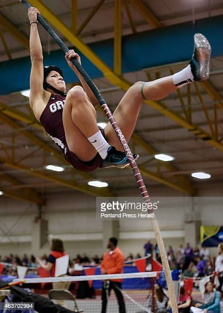 Alyssa Coyne of Greely competes in the pole vault during the Class B indoor track and field championship meet