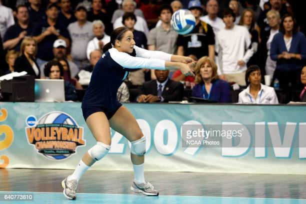 Alyssa D'Errico of Penn State University hits a dig against the University of Texas during the Division I Women's Volleyball Championship held at the...