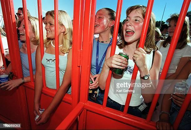 Alyssa Detert of Fort Collins and her best friend Jennifer Fernandez of Denver wait to get into Mile High Stadium for the 'NSYNC concert
