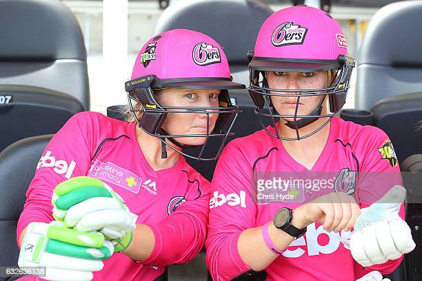 Alyssa Healy and Dane van Niekerk of the Sixers looks on during the Women's Big Bash League semi final match between the Sydney Sixers and the Hobart...