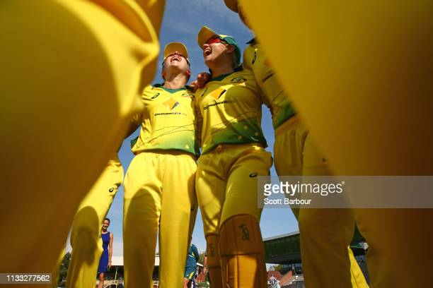 Alyssa Healy and Elyse Villani of Australia form a team huddle with their teammates during game three of the One Day International Series between...