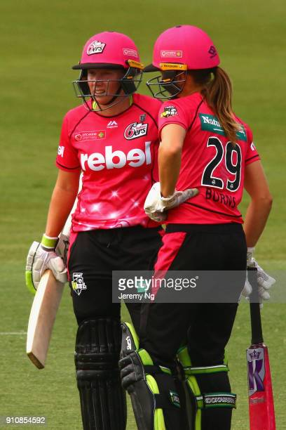 Alyssa Healy and Erin Burns of the Sixers look on during the Women's Big Bash League match between the Adelaide Strikers and the Sydney Sixers at...