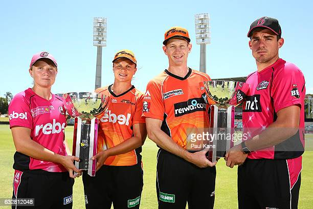 Alyssa Healy and Moises Henriques of the Sixers pose with WBBL and BBL trophies togerther with Suzie Bates and Adam Voges of the Scorchers during a...