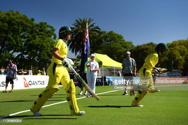 Alyssa Healy and Rachael Haynes of Australia run out to bat during game two of the One Day International Series between Australia and New Zealand at...