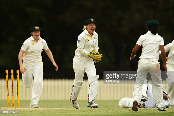 Alyssa Healy of Australia celebrates after running out Isa Guha of England off a Rachael Haynes throw during day three of the Test match between the...