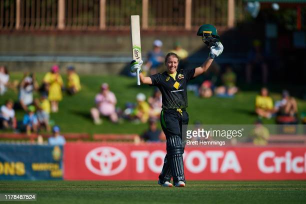 Alyssa Healy of Australia celebrates after scoring a century during game three of the Women's Twenty20 International Series between Australia and Sri...