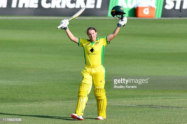 Alyssa Healy of Australia celebrates scoring a century during Game 3 of the One Day International Series between Australia and Sri Lanka at Allan...