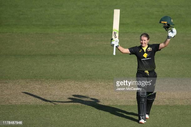 Alyssa Healy of Australia celebrates scoring a century during game three of the Women's Twenty20 International Series between Australia and Sri Lanka...
