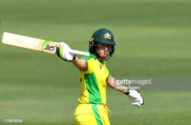 Alyssa Healy of Australia celebrates scoring a half century during Game 3 of the One Day International Series between Australia and Sri Lanka at...