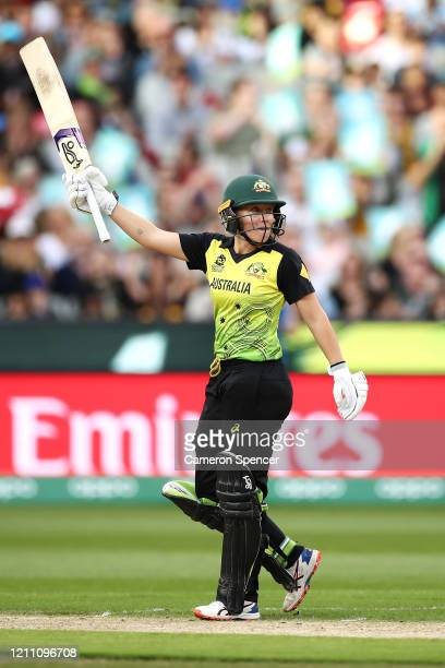 Alyssa Healy of Australia celebrates scoring a half century during the ICC Women's T20 Cricket World Cup Final match between India and Australia at...