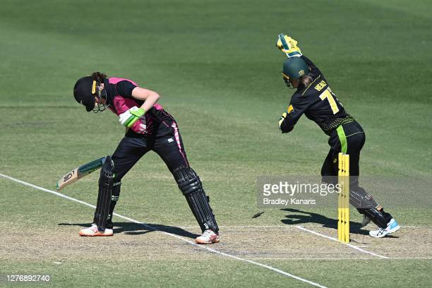 Alyssa Healy of Australia celebrates taking the wicket of Amy Satterthwaite of New Zealand by stumping during game two of the T20 Women's...