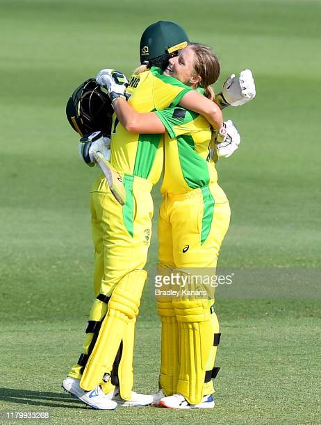 Alyssa Healy of Australia celebrates with Meg Lanning after scoring a century during Game 3 of the One Day International Series between Australia and...