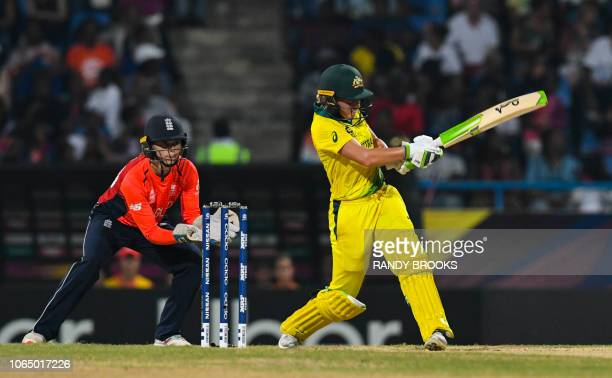 Alyssa Healy of Australia hits 4 as Amy Jones of England looks on during the ICC Women's World T20 final cricket match between Australia and England...