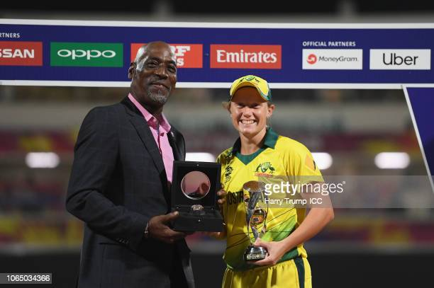Alyssa Healy of Australia is presented with the Player of the Tournament award by Sir Viv Richards during the ICC Women's World T20 2018 Final...