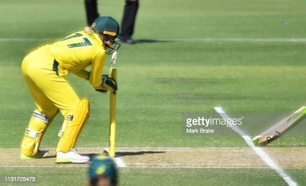 Alyssa Healy of Australia runs out Amy Satterthwaite of New Zealand during game two of the One Day International Series between Australia and New...