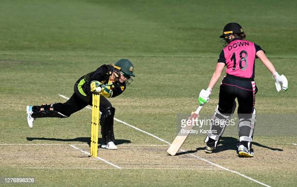 Alyssa Healy of Australia takes a catch to dismiss Lauren Down of New Zealand during game two of the T20 Women's International series between...