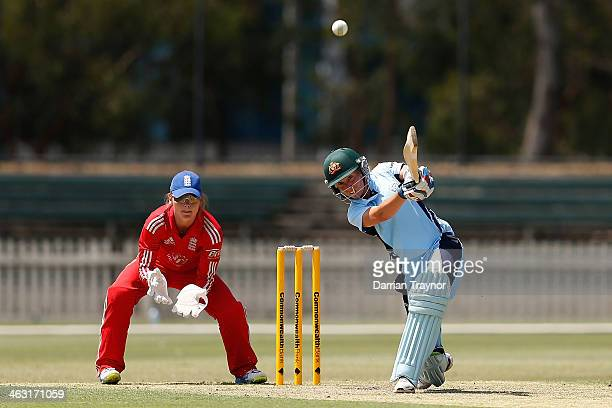 Alyssa Healy of New South Wales hits a ball for 4 runs as wicketkeeper Amy Jones looks on during the International Tour match between the Chairman's...