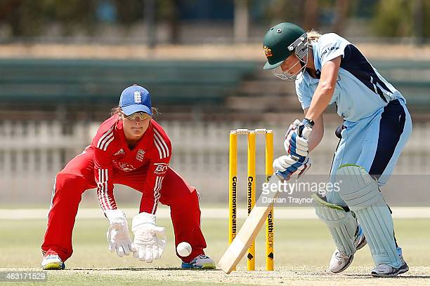 Alyssa Healy of New South Wales plays a shot watched by wicketkeeper Amy Jones of England during the International Tour match between the Chairman's...