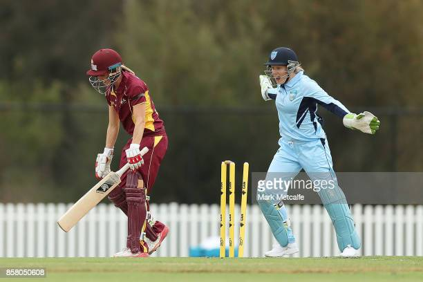 Alyssa Healy of NSW celebrates the wicket of Kirby Short of Queensland off the bowling of Nicola Carey of NSW during the WNCL match between New South...