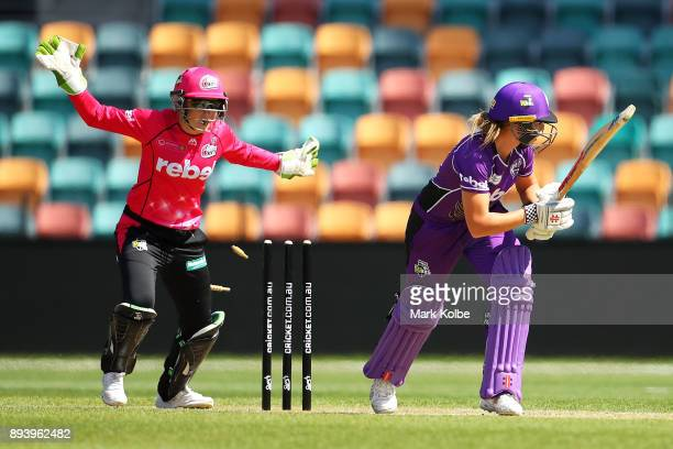 Alyssa Healy of the Sixers celebrates after Lauren Winfield of the Hurricanes is bolwed by Sarah Aley of the Sixers during the Women's Big Bash...