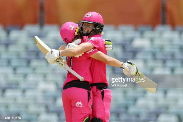 Alyssa Healy of the Sixers celebrates after scoring a century during the Women's Big Bash League match between the Sydney Sixers and the Melbourne...