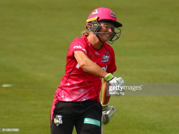 Alyssa Healy of the Sixers celebrates her century during the Women's Big Bash League match between the Adelaide Strikers and the Sydney Sixers at...