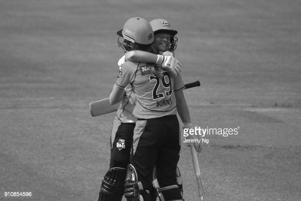 Alyssa Healy of the Sixers celebrates her century with Erin Burns during the Women's Big Bash League match between the Adelaide Strikers and the...