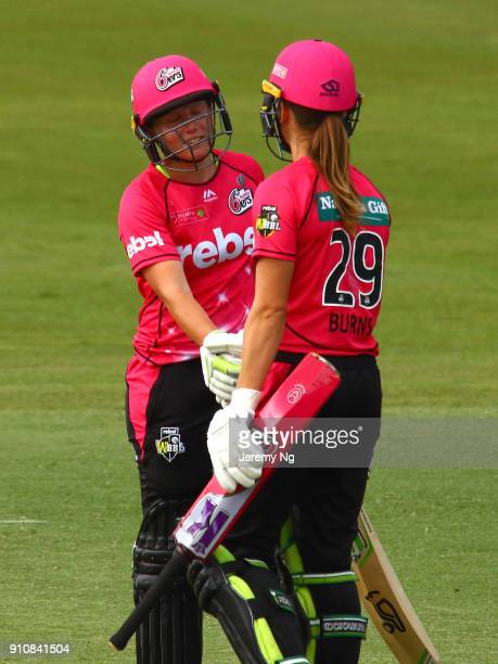 Alyssa Healy of the Sixers celebrates her half century with Erin Burns during the Women's Big Bash League match between the Adelaide Strikers and the...