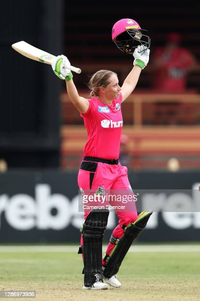 Alyssa Healy of the Sixers celebrates scoring a century during the Women's Big Bash League WBBL match between the Melbourne Stars and the Sydney...