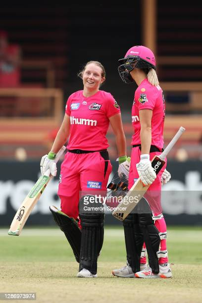 Alyssa Healy of the Sixers celebrates scoring a century with team mate Ellyse Perry of the Sixers during the Women's Big Bash League WBBL match...