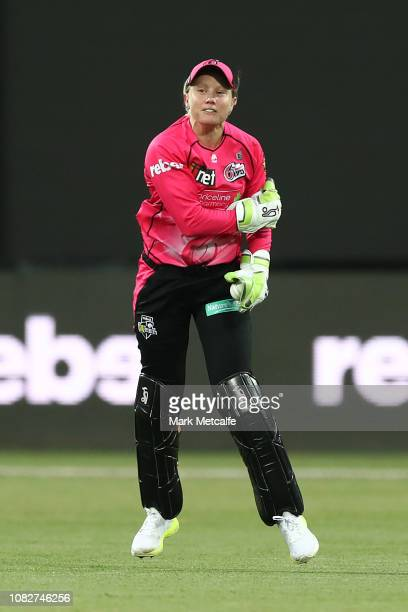 Alyssa Healy of the Sixers celebrates taking a catch to dismiss Stefanie Daffara of the Hurricanes during the Women's Big Bash League match between...