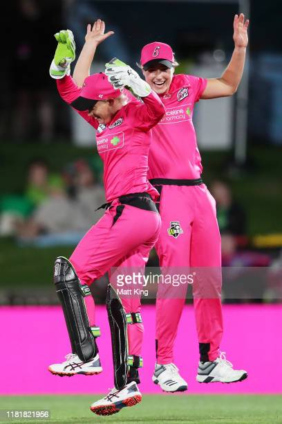 Alyssa Healy of the Sixers celebrates with Ellyse Perry after taking a catch to dismiss Rachael Haynes of the Thunder during the Women's Big Bash...