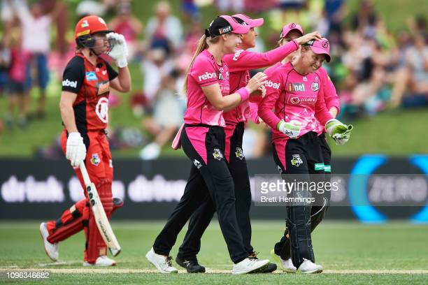 Alyssa Healy of the Sixers celebrates with team mates after taking the wicket of Sophie Molineux of the Renegades during the Women's Big Bash League...