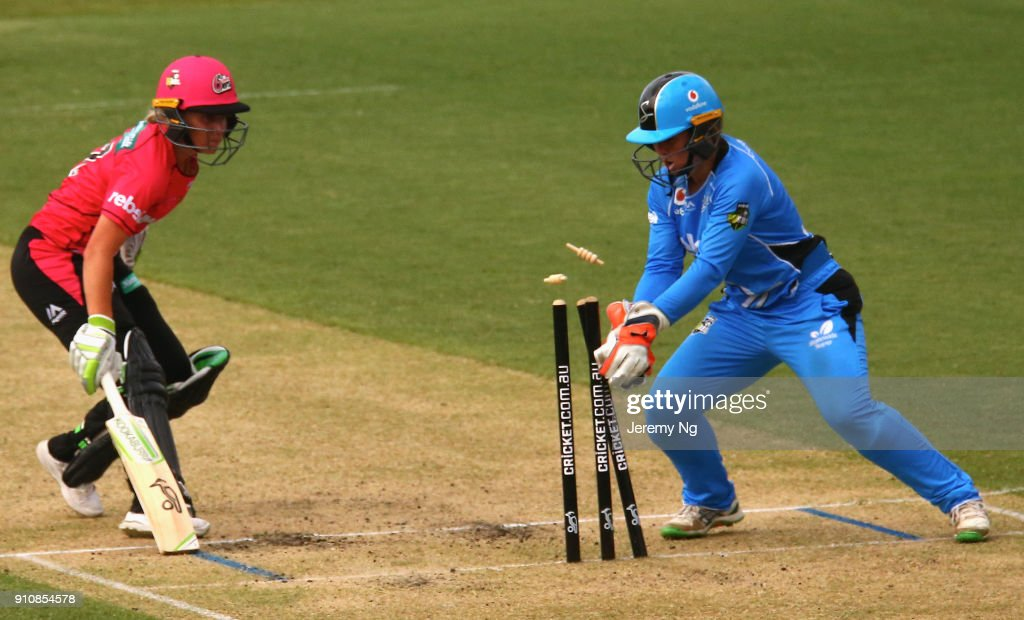 Alyssa Healy of the Sixers makes her ground as Tegan McPharlin of the Strikers gathers the ball during the Women's Big Bash League match between the Adelaide Strikers and the Sydney Sixers at Hurstville Oval on January 27, 2018 in Sydney, Australia.