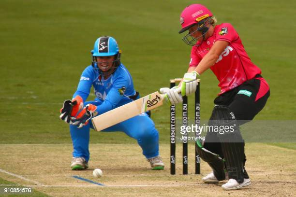 Alyssa Healy of the Sixers plays a cut shot during the Women's Big Bash League match between the Adelaide Strikers and the Sydney Sixers at...