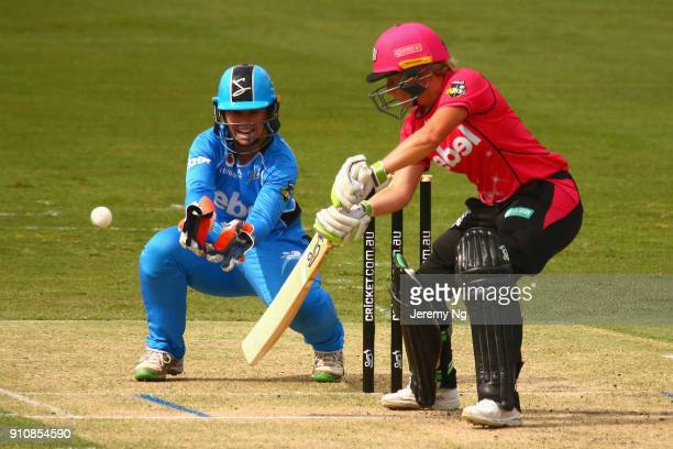 Alyssa Healy of the Sixers plays a shot as Tegan McPharlin of the Strikers wicketkeeps during the Women's Big Bash League match between the Adelaide...