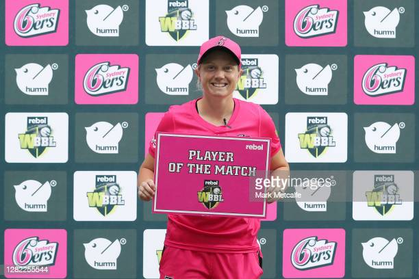 Alyssa Healy of the Sixers poses with the player of the match award during the Women's Big Bash League WBBL match between the Sydney Sixers and the...