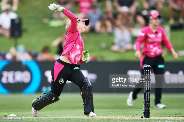 Alyssa Healy of the Sixers runs out Sophie Molineux of the Renegades during the Women's Big Bash League match between the Sydney Sixers and the...
