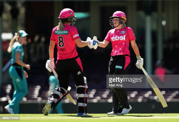 Alyssa Healy of the Sixers shakes hands with Ellyse Perry after scoring 50 runs during the Women's Big Bash League match between the Sydney Sixers...